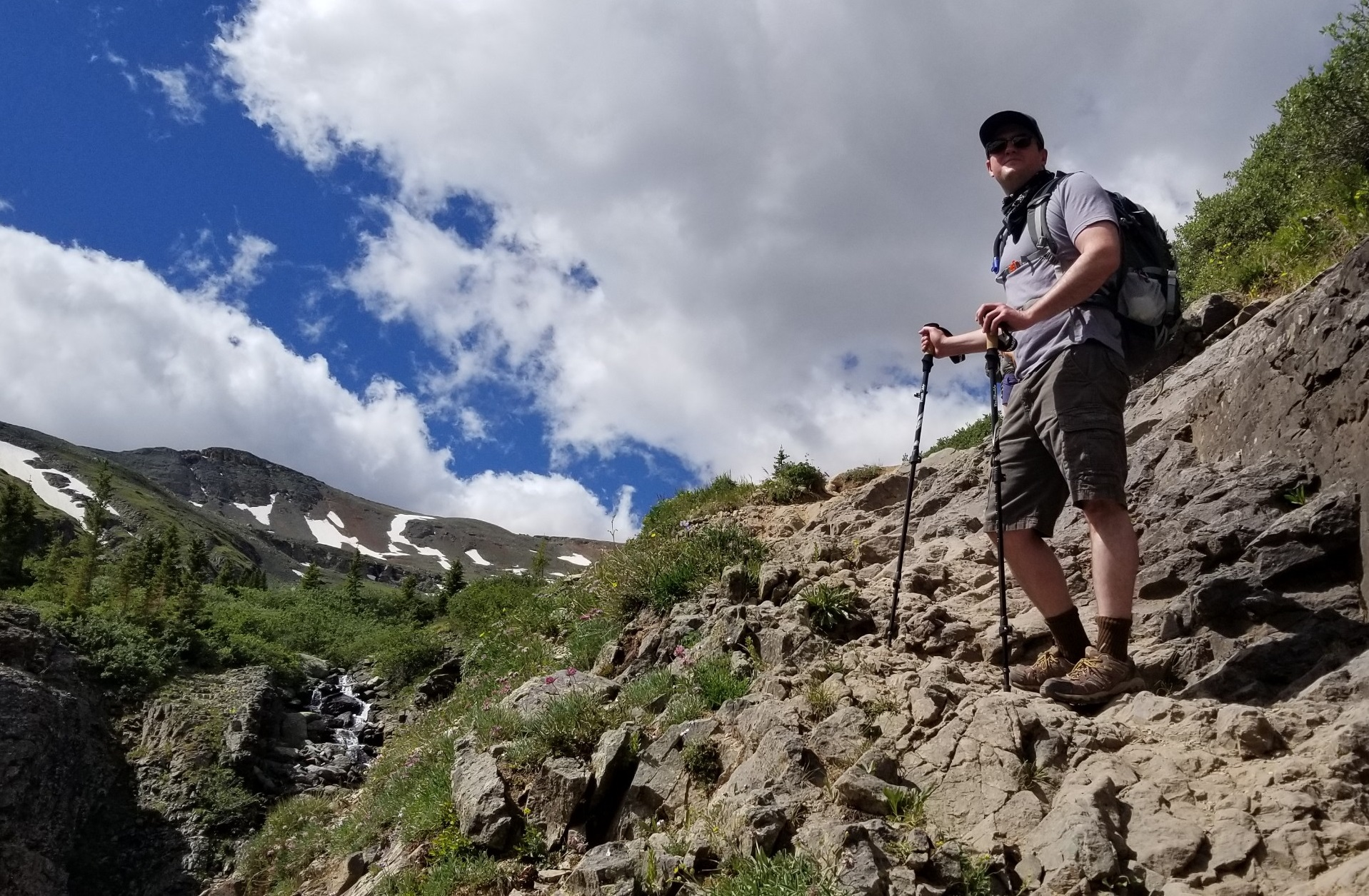 Hiking Ice Lakes Trail in the San Juan mountains near Silverton, Colorado on a beautiful summer day.