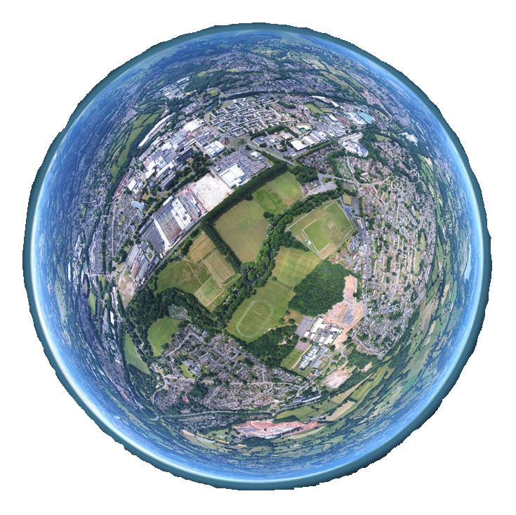 A fish-eye perspective of Earth zoomed in to reveal the details of parks, neighborhoods, and shopping centers. A hazy blue border surrounds the edge of the sphere.